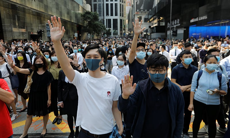 Demonstrators raise their hands as they take to the streets during a protest at the Central District in Hong Kong, China on November 15, 2019. — Reuters