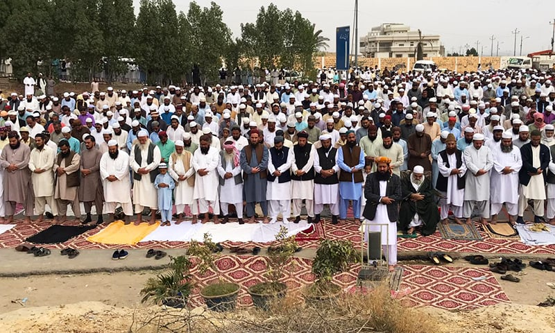 JUI-F workers offered Friday prayers on Karachi's Hub Road, which has been blocked as part of the party's anti-government protest. — Photo provided by Ismail Sasoli
