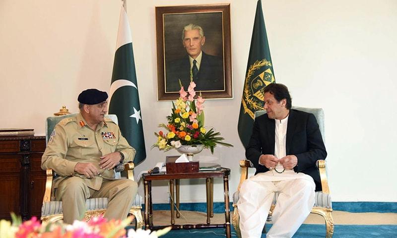 General Qamar Bajwa meets Prime Minister Imran Khan at PM House on November 15. — PID