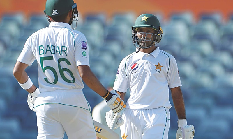 Pakistan's century-maker Asad Shafiq (R) in discussion with Babar Azam during their 100-plus partnership in the tour match against Cricket Australia XI at the WACA Ground on Friday.—Courtesy AAP