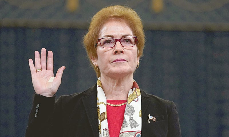 Washington: Marie Yovanovitch, a former US ambassador to Ukraine, takes oath before her testimony.—Reuters