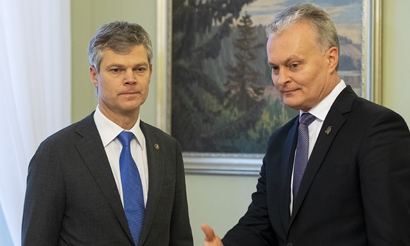 Lithuania's President Gitanas Nauseda, right, welcomes Director of the State Security Department Darius Jauniskis prior to their meeting at the Presidential palace in Vilnius, Lithuania on Friday, November 15, 2019. — AP
