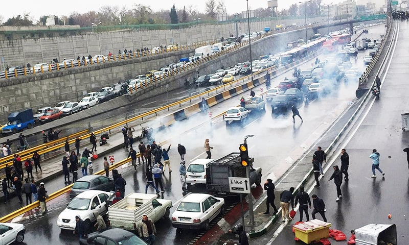 People protest against increased gas price, on a highway in Tehran, Iran November 16, 2019. — WANA via Reuters