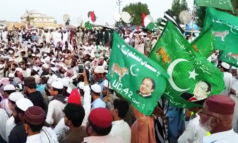 Several PML-N workers at the sit-in are holding party flags.— Photo provided by Ismail Sasoli