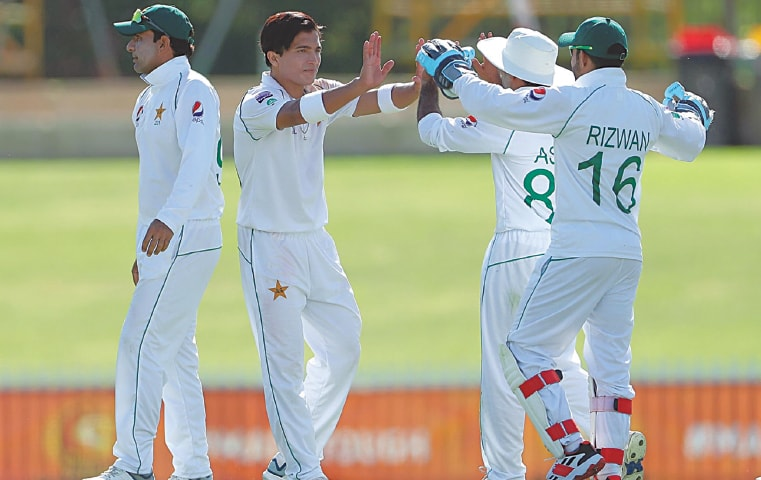 PAKISTAN paceman Mohammad Musa Khan (second L) celebrates with team-mates after taking a wicket during the tour match against Cricket Australia XI at the WACA Ground on Saturday.—Courtesy AAP
