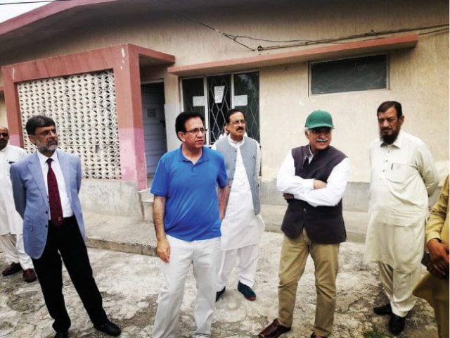 Special Assistant to the Prime Minister on Health Dr Zafar Mirza inspects an under-construction basic health unit in Kirpa. — Photo by the writer