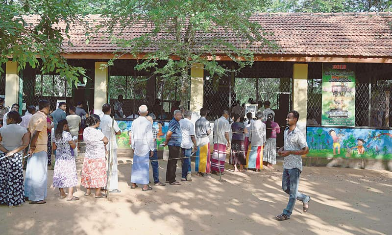 WEERAWILA (Sri Lanka): People queue up at a polling station on Saturday to cast their ballots.—AFP