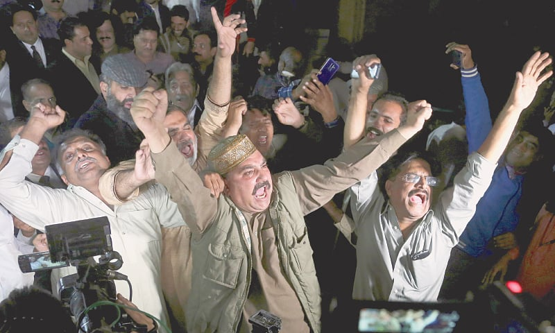 LAHORE: Supporters of former prime minister Nawaz Sharif celebrate the court decision on Saturday.—AP