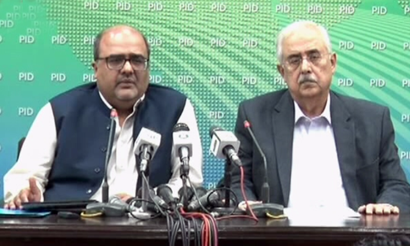 Special Assistant to the Prime Minister on Accountability Shahzad Akbar addresses a press conference with Attorney General Anwar Mansoor Khan. — DawnNewsTV