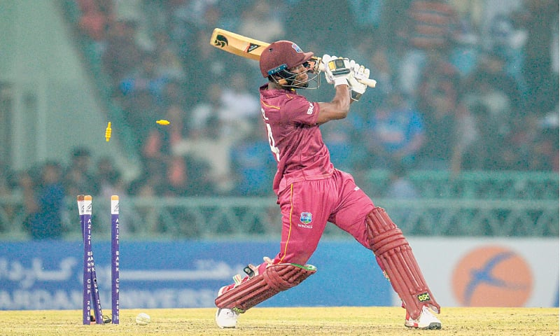 LUCKNOW: West Indies all-rounder Keemo Paul is bowled out by Afghanistan's Karim Janat during the second Twenty20 International at the Ekana Cricket Stadium.—AFP