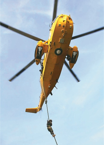 KARACHI: A participant of the Shaheen Al Jazeera exercise rappels down a helicopter on Sunday.—APP