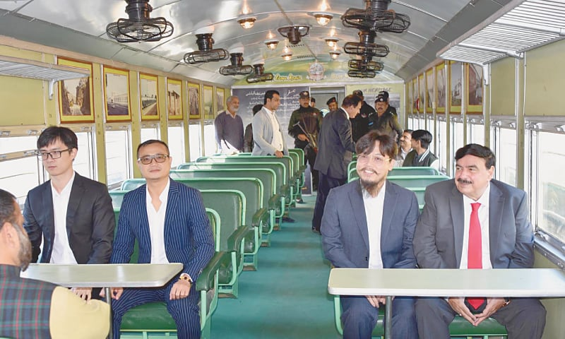 RAWALPINDI: Federal Railways Minister Sheikh Rashid Ahmed travels with foreign tourists in the Steam Engine Safari Train.—Online