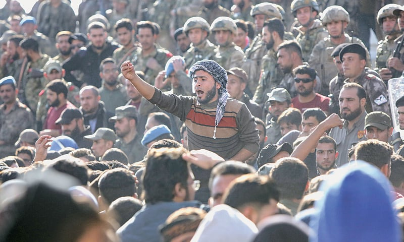 AL BAB (Syria): Protesters shout slogans during a demonstration against Turkish presence in this town in northern Syria on Sunday.—AFP