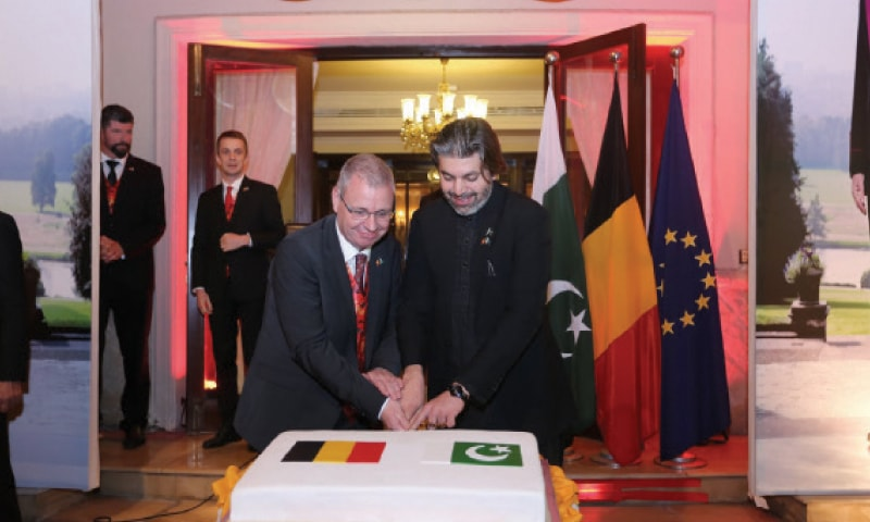 Belgian Ambassador Philippe Bronchain and Minister of State for Parliamentary Affairs Ali Mohammad Khan cut a cake on the occasion of the Belgian King's Day in Islamabad.