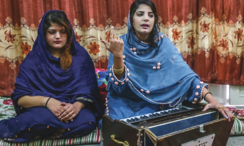 Local singers Uzma Fayaz and Gulalai perform at a function in Swat. — Dawn