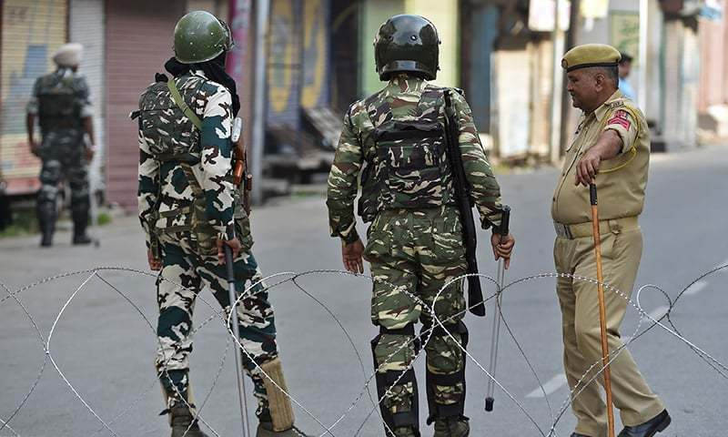 Indian paramilitary troopers stand guard during a lockdown in Srinagar in occupied Kashmir on September 6. — AFP/File
