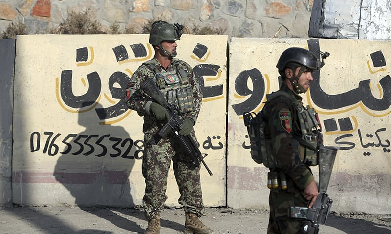 National army soldiers stand guard in front of the Kabul Military Training Center in Kabul, Afghanistan on  Monday.  — AP