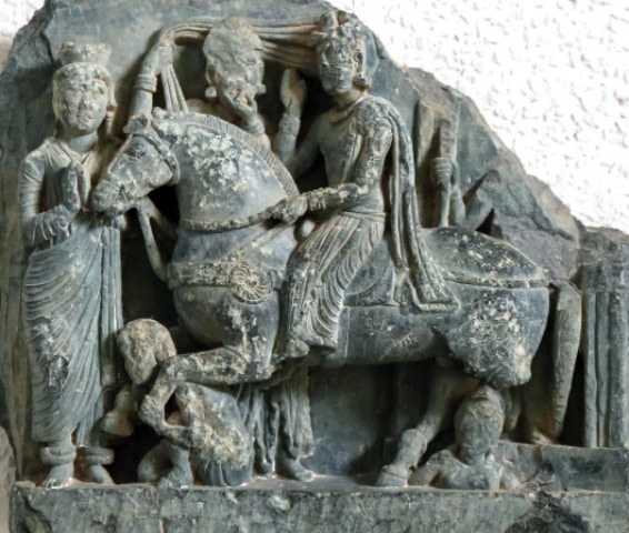 The relief depicting the great departure of Gautama Buddha exhibited in Swat Museum. — Dawn