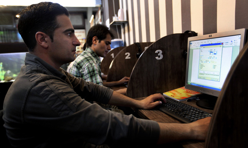 In this May 27, 2013 file photo, Iranians surf the web at an Internet cafe, in Tehran, Iran. — AP/File