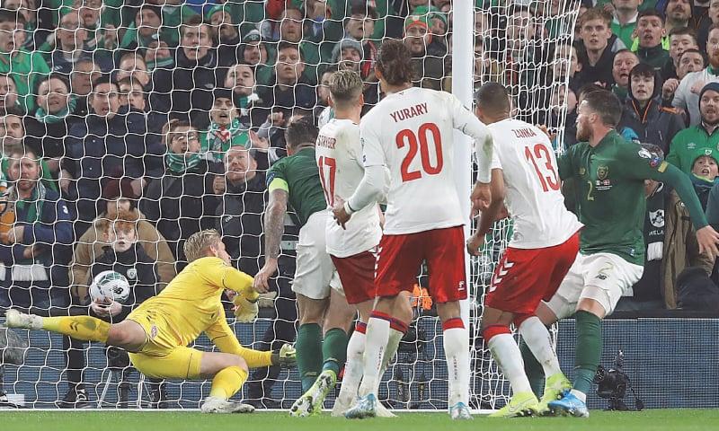DUBLIN: Republic of Ireland's Matt Doherty (R) watches his header beat Denmark goalkeeper Kasper Schmeichel for a goal during their Euro 2020 Group 'D' qualifier at the Aviva Stadium.—AFP