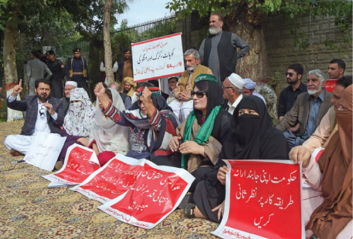 Opposition members stage a protest sit-in outside the CM secretariat, Peshawar, on Tuesday. — White Star