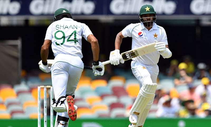 Pakistan's batsmen Azhar Ali (R) and Shan Masood run between the wickets on day one of the first Test cricket match between Pakistan and Australia at the Gabba in Brisbane on November 21, 2019. — AFP