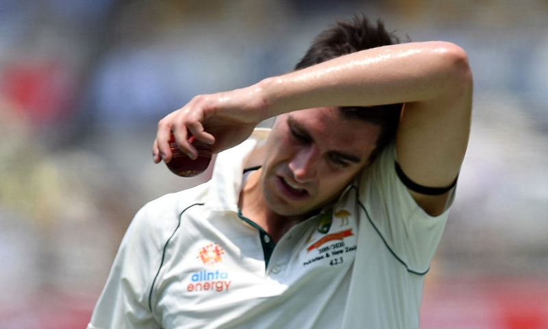 Australia's paceman Pat Cummins gestures as he gets ready to bowl on day one of the first Test cricket match between Pakistan and Australia at the Gabba in Brisbane on November 21, 2019. — AFP