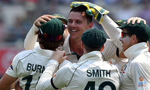Australia's paceman Josh Hazlewood (C) celebrates his wicket of Pakistan's Babar Azam with teammates on day one of the first Test cricket match between Pakistan and Australia at the Gabba in Brisbane on November 21, 2019. — AFP