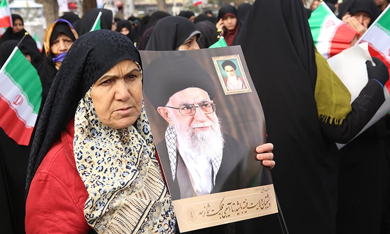 "Iranian government supporters rally on November 20 in support of the Islamic republic's authorities and supreme leader, Ayatollah Ali Khamenei (portraits), in the cenral city of Arak, southwest of the capital Tehran, as President Hassan Rouhani said the country's people had defeated an ""enemy conspiracy"" behind a wave of violent street protests. — AFP"