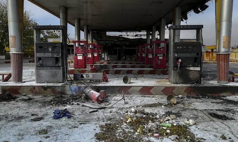 This photo released by the Iranian Students' News Agency, ISNA, shows a gas station that was burned during protests that followed authorities' decision to raise gasoline prices, in Tehran, Iran on Sunday. — ISNA via AP