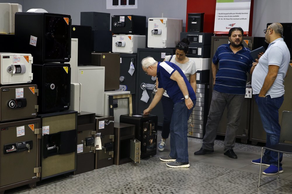 Customers check the safes for sale at the Shehab Security shop in Beirut, Lebanon, on Nov 20. ─ AP