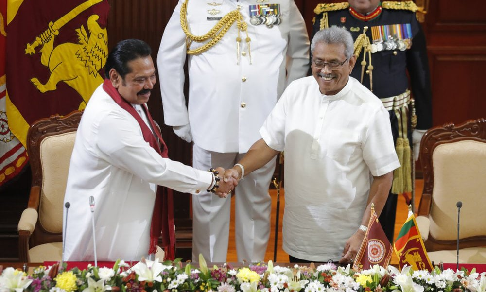 Sri Lanka's president Gotabaya Rajapaksa, right, greets his brother Mahinda after appointing him as prime minister at the presidential secretariat in Colombo, Sri Lanka, on Thursday. — AP