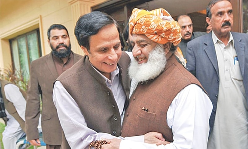 JUI-F chief Fazlur Rehman and PML-Q's Chaudhry Pervez Elahi meet in Islamabad. — INP/File