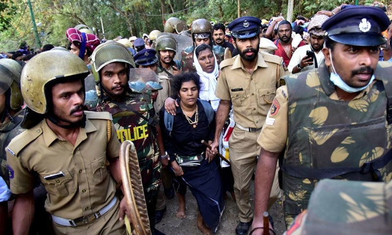 Bindu Ammini, 42, and Kanaka Durga, 44, are escorted by police after they attempted to enter the Sabarimala temple in Pathanamthitta district in the southern Indian state of Kerala, Dec 24, 2018. — Reuters/File