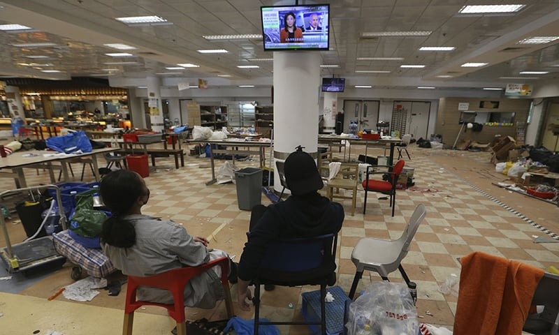 Protesters watch TV inside the campus of Hong Kong Polytechnic University in Hong Kong on Friday, November 22, 2019. — AP