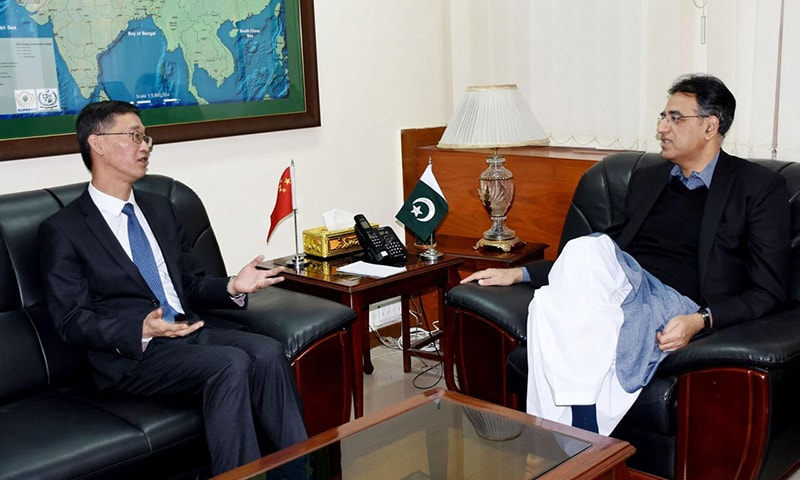 Minister for Planning and Development Asad Umar in a meeting with Chinese Ambassador to Pakistan Yao Jing. — PID