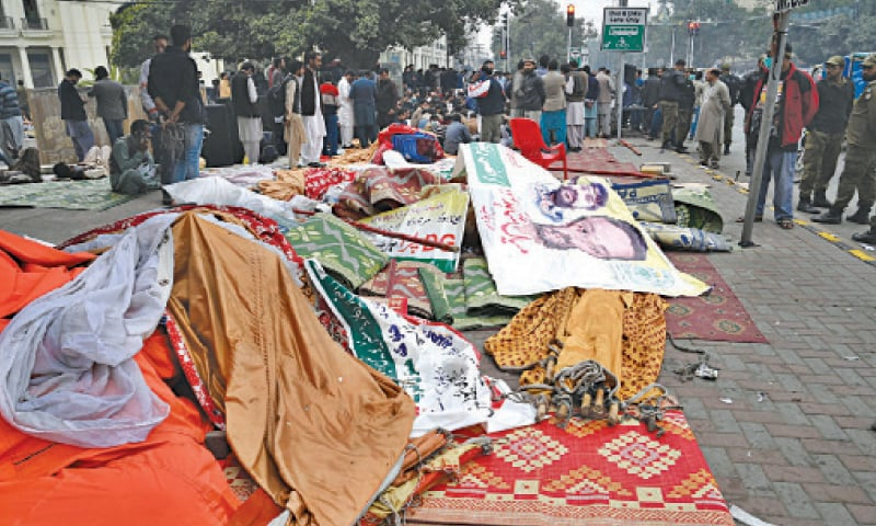 Sick of frequent demonstrations on The Mall, traders dismantle a protest camp set up by striking staff of the Punjab Land Record Authority on Friday. — White Star