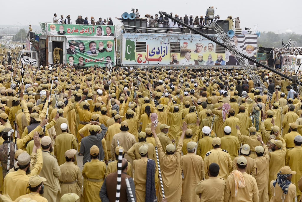 JUI-F leadership addresses supporters while standing atop a container | Tanveer Shahzad/White Star