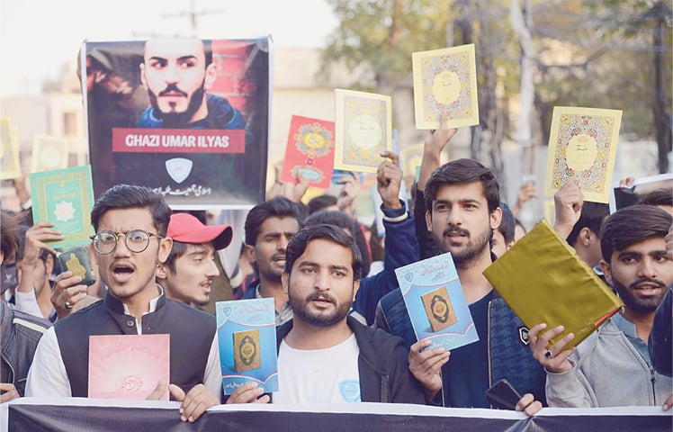 LAHORE: Activists of Islami Jamiat-i-Talba on Saturday protest outside the press club against the desecration of the Holy Quran in Norway.—Online