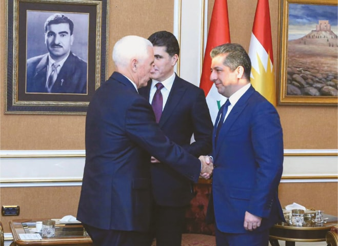 Erbil: US Vice President Mike Pence (left) being greeted by Masrour Barzani, the prime minister of the Kurdish regional government, as President Nechirvan Barzani (centre) looks on.—AFP