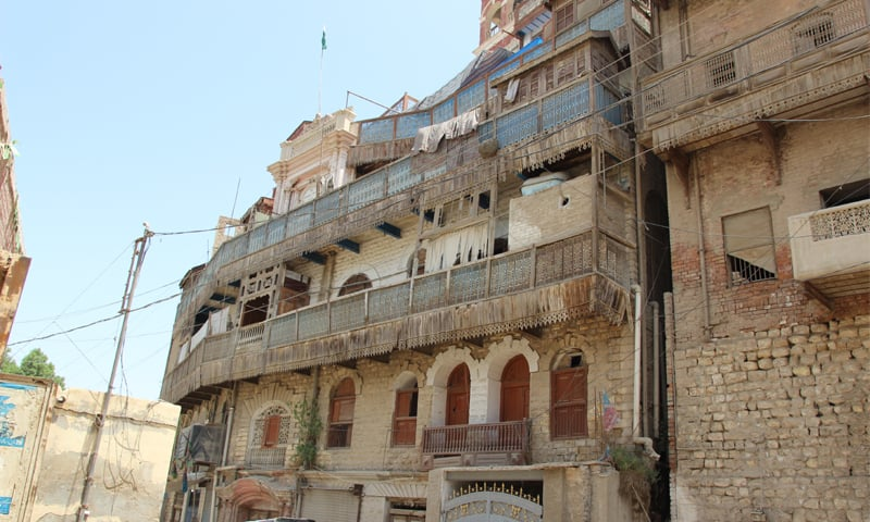 The overhung balconies supported by wood cornices -Photos by the writer