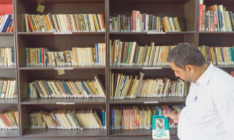 A MAN stands in front of a collection of Russian literature and books translated into Urdu at the Russian Cultural centre.—Mohammad Ali / White Star