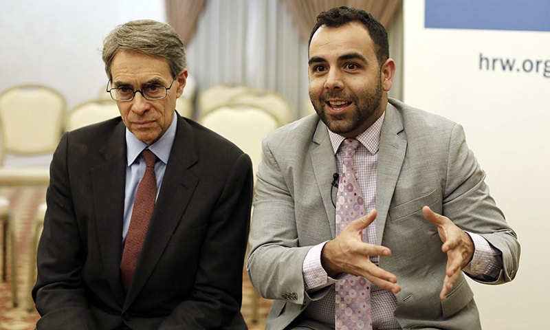 Kenneth Roth (L) the Executive Director of Human Rights Watch (HRW) and  US citizen Omar Shakir, the New York-based rights group HRW director for Israel and the Palestinian territories speak during an interview at an east Jerusalem hotel, on November 24, ahead of his expulsion from Israel.  — AFP
