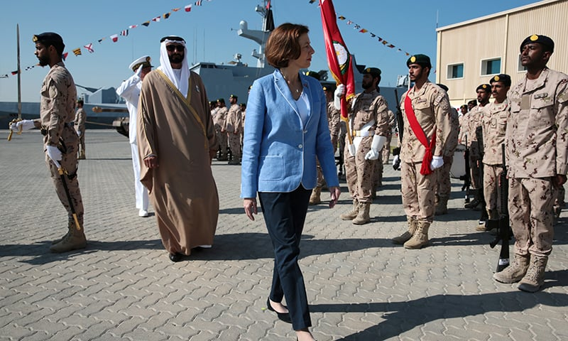 French Defence Minister Florence Parly and United Arab Emirates' Minister of State for Defence Mohammed Bin Ahmad al-Bawardi inspect members of an honour guard during a military ceremony at the French Naval Base in Abu Dhabi, United Arab Emirates on November 24. — Reuters