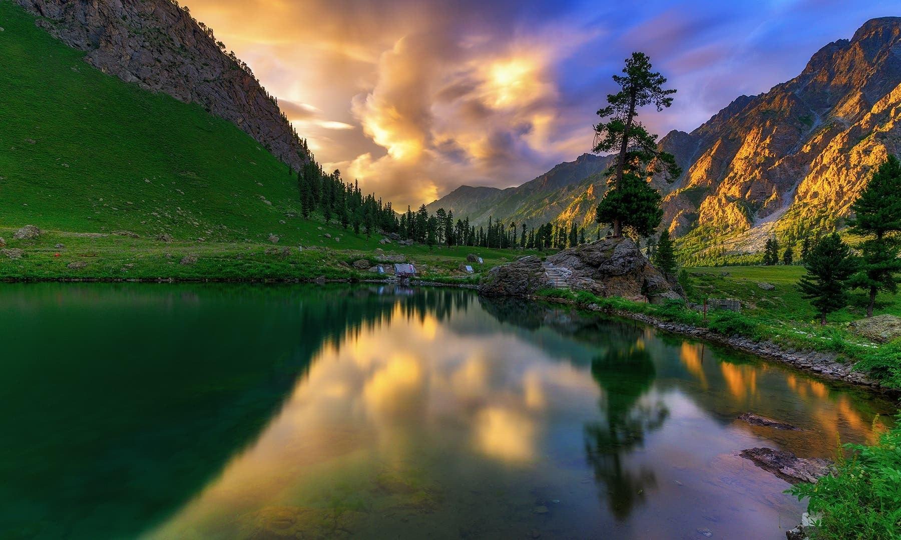 Rainbow lake reflects the beauty of Domel. — Photo by Syed Mehdi Bukhari