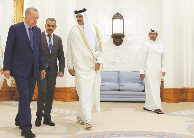 Doha: Qatar's Emir Sheikh Tamim bin Hamad al-Thani welcoming Turkish President Recep Tayyip Erdogan on Monday.—AFP