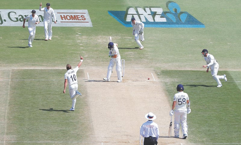 New Zealand paceman Neil Wagner celebrates after dismissing England batsman Jos Buttler in the first Test at the Bay Oval on Monday.—AP