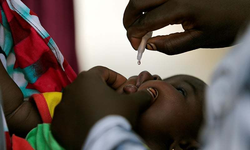 A child is given a dose of polio vaccine at an immunisation health centre in Maiduguri, Borno State, Nigeria on August 29, 2016. — Reuters/File