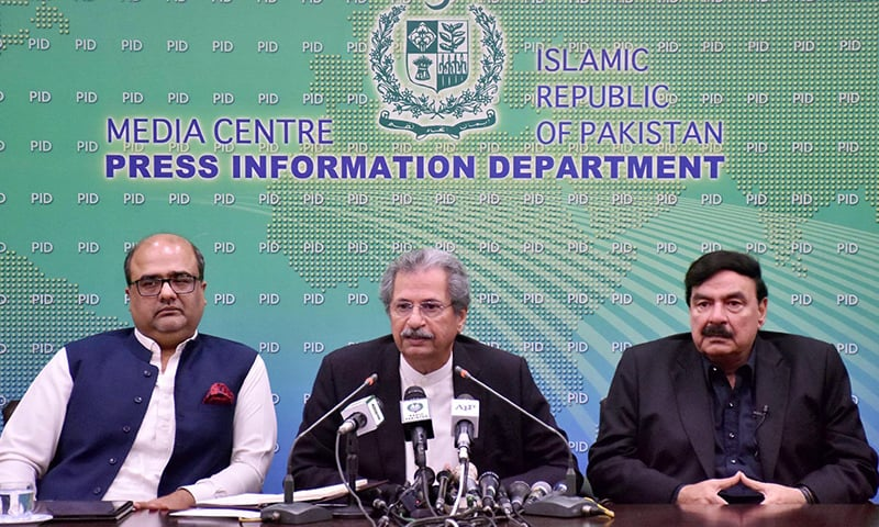 Minister for Education Shafqat Mehmood addresses a press conference alongwith Minister for Railways Sheikh Rasheed and SAPM on Accountability Shahzad Akbar on Tuesday. — PID