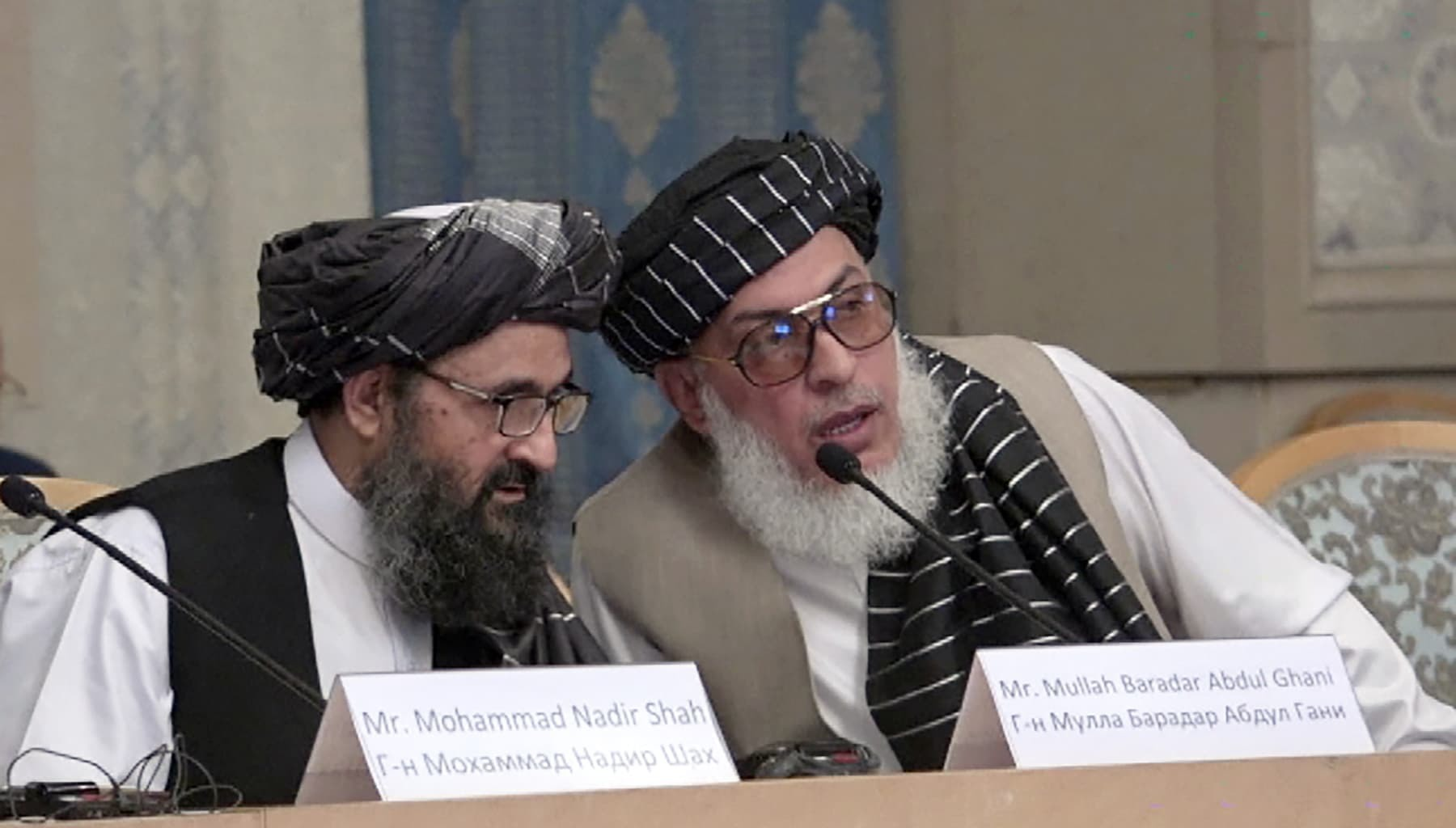 This screengrab from a video made on May 28, 2019 in Moscow shows Mullah Abdul Ghani Baradar (R) and Stanakzai Sher Mohammad Abbas, Taliban chief negotiators during a conference. — AFP/File